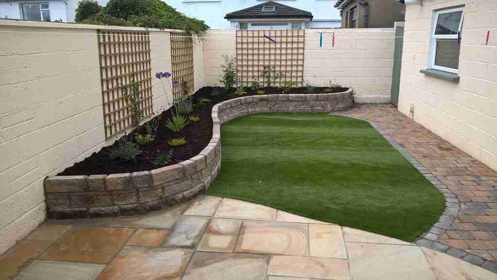 Low Maintenance Garden, Synthetic lawn & Sandstone Patio, Raised beds . Georgian Close, Drogheda co.Louth