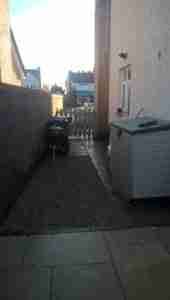 Photo of New paved and gravelled area for bins and storage units