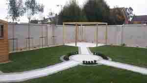 image of newly constructed Pergola patio and tree screening with box hedging to surround of circular paving