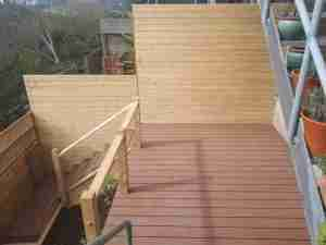 Side view of new deck and timber cladding boundary fencing