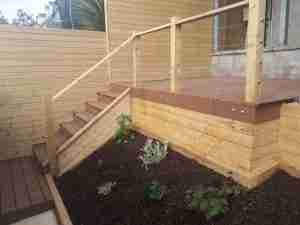 Image of new Contemporary decking and timber clad fencing and raised bed