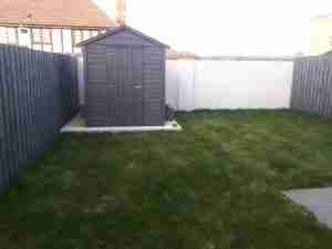 Image of a shed and blank garden space
