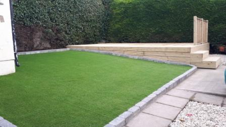 New dog friendly artificial lawn and decking