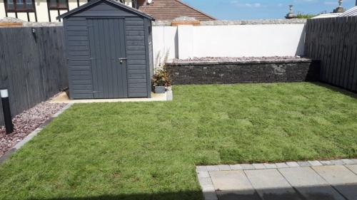Turf lawn with mowing brick edging ,Raised Connemara Walling ,lighting