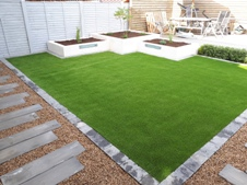 Artificial lawn and Raised white rendered beds