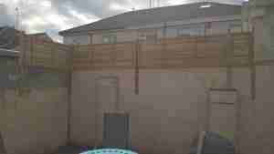 Timber screening on top of wall