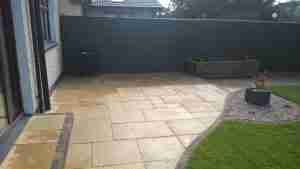 Image of the new Larger patio area in yellow limestone paving