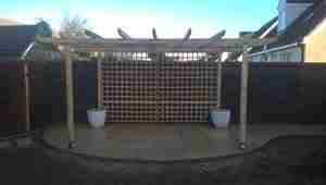 Photo of Timber Pergola and Yellow limestone patio