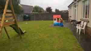 Photo of bare garden no plants, swing set