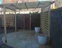 Photo of oil tank screening with willow frames