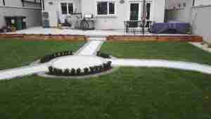 Image of New lawn path and circular paving with box hedging