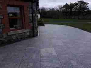 Image of 600x 600mm silver granite slabs in patio