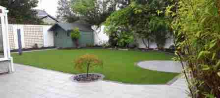 Low Maintenance Garden Design With Silver Granite Flag Paving & Artificial lawn