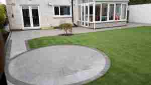 Image of flame finish silver granite circle patio