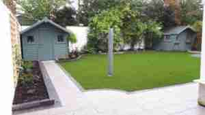 Image of new path and artificial lawn raised beds and garden space