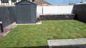 Image of New raised bed with lighting new turf lawn and brick and gravel edging in the garden