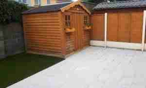 Image of Silver granite paving and artificial lawn