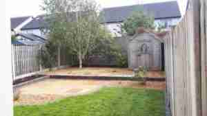 Image of new terraced garden with gravel surfacing,limestone paving and birch tree