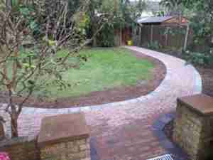 Image of new curving path to shed with new bed to side