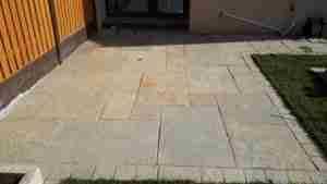 Yellow Limestone patio with yellow limestone tumbler edging