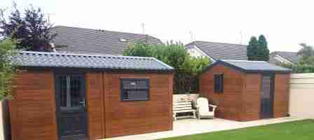 Low maintenance Garden:Artificial lawn, paving and Steel sheds