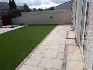 Image of New Cheisa paving and steps into house with artificial lawn