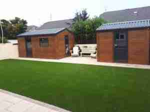 Steel sheds paving and artificial lawn