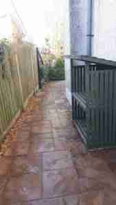 Image of new paving to side of house with gravel border for drainage