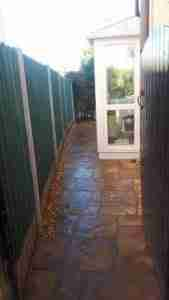 New paving to side of house with gravel border for drainage