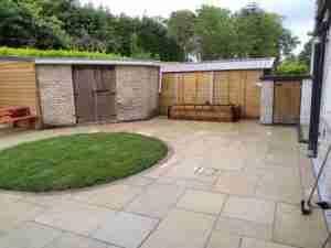 Yellow limestone patio with circular lawn