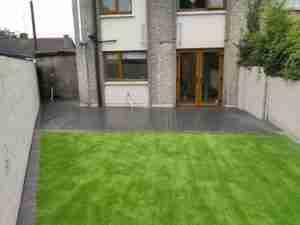Lush looking artificial lawn and contemporary soft grey composite deck