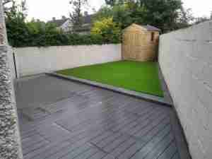 New redesigned outdoor space with artificial lawn and soft grey composite decking