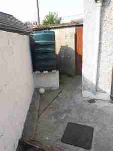 Image of side of garden and oil tank