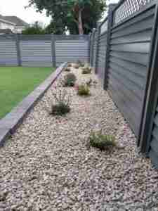 Image of gravel border with cottage perennials and decorative gravel mulch