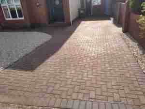 Image of cleaned sanded and sealed driveway