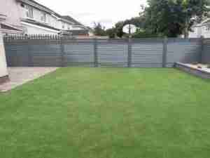 Side Image of garden with Elite Slaney fencing , Artificial lawn and Connemara walling raised bed