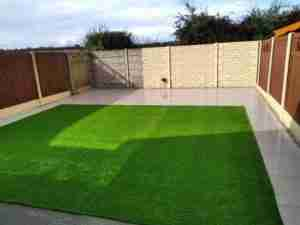 View of more spacious garden with  easy to keep lawn and patio
