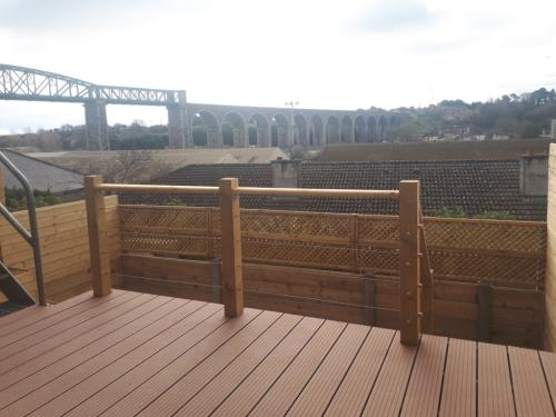 Contemporary composite decking with handrail and marine cabling