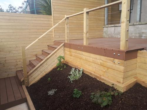 New contemporary decking and raised beds